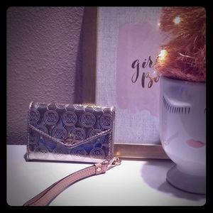 Michael Kors gold wristlet